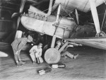 Members of 3 AFC, fixing bombs to their plane   AWM  E01176